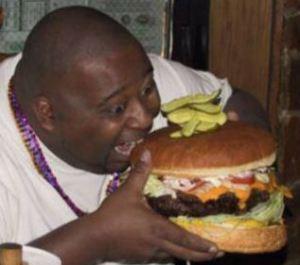 fat-man-eating-burger